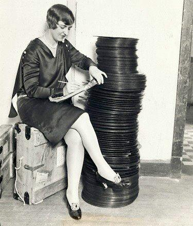 A Warner Brothers employee in Chicago inspects Vitaphone disks before shipping them out